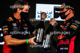(L to R): Paul Monaghan (GBR) Red Bull Racing Chief Engineer celebrates with race winner Max Verstappen (NLD) Red Bull Racing on the podium. 13.12.2020. Formula 1 World Championship, Rd 17, Abu Dhabi Grand Prix, Yas Marina Circuit, Abu Dhabi, Race Day.