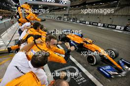 McLaren celebrates as Carlos Sainz Jr (ESP) McLaren MCL35 finishes the race. 13.12.2020. Formula 1 World Championship, Rd 17, Abu Dhabi Grand Prix, Yas Marina Circuit, Abu Dhabi, Race Day.