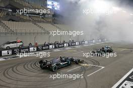Valtteri Bottas (FIN) Mercedes AMG F1 W11 and Lewis Hamilton (GBR) Mercedes AMG F1 W11 - doughnuts at the end of the race. 13.12.2020. Formula 1 World Championship, Rd 17, Abu Dhabi Grand Prix, Yas Marina Circuit, Abu Dhabi, Race Day.