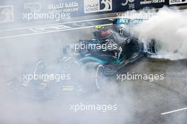 Valtteri Bottas (FIN) Mercedes AMG F1 W11 - doughnuts at the end of the race. 13.12.2020. Formula 1 World Championship, Rd 17, Abu Dhabi Grand Prix, Yas Marina Circuit, Abu Dhabi, Race Day.