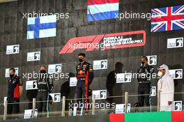 The podium (L to R): Paul Monaghan (GBR) Red Bull Racing Chief Engineer; Valtteri Bottas (FIN) Mercedes AMG F1, second; Max Verstappen (NLD) Red Bull Racing, race winner; Lewis Hamilton (GBR) Mercedes AMG F1, third.. 13.12.2020. Formula 1 World Championship, Rd 17, Abu Dhabi Grand Prix, Yas Marina Circuit, Abu Dhabi, Race Day.