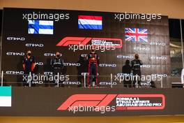 The podium (L to R): Paul Monaghan (GBR) Red Bull Racing Chief Engineer; Valtteri Bottas (FIN) Mercedes AMG F1, second; Max Verstappen (NLD) Red Bull Racing, race winner; Lewis Hamilton (GBR) Mercedes AMG F1, third. 13.12.2020. Formula 1 World Championship, Rd 17, Abu Dhabi Grand Prix, Yas Marina Circuit, Abu Dhabi, Race Day.