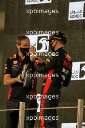 Race winner Max Verstappen (NLD) Red Bull Racing celebrates on the podium with Paul Monaghan (GBR) Red Bull Racing Chief Engineer. 13.12.2020. Formula 1 World Championship, Rd 17, Abu Dhabi Grand Prix, Yas Marina Circuit, Abu Dhabi, Race Day.