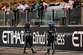 (L to R): Lewis Hamilton (GBR) Mercedes AMG F1 and team mate Valtteri Bottas (FIN) Mercedes AMG F1 at the end of the race. 13.12.2020. Formula 1 World Championship, Rd 17, Abu Dhabi Grand Prix, Yas Marina Circuit, Abu Dhabi, Race Day.