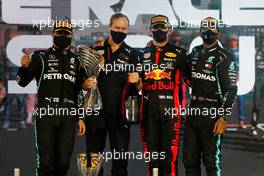 The podium (L to R): Valtteri Bottas (FIN) Mercedes AMG F1, second; Paul Monaghan (GBR) Red Bull Racing Chief Engineer; Max Verstappen (NLD) Red Bull Racing, race winner; Lewis Hamilton (GBR) Mercedes AMG F1, third. 13.12.2020. Formula 1 World Championship, Rd 17, Abu Dhabi Grand Prix, Yas Marina Circuit, Abu Dhabi, Race Day.