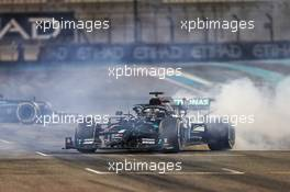 Lewis Hamilton (GBR) Mercedes AMG F1 W11 and Valtteri Bottas (FIN) Mercedes AMG F1 W11 - doughnuts at the end of the race. 13.12.2020. Formula 1 World Championship, Rd 17, Abu Dhabi Grand Prix, Yas Marina Circuit, Abu Dhabi, Race Day.