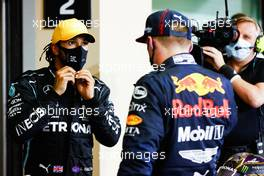 (L to R): Lewis Hamilton (GBR) Mercedes AMG F1 with race winner Max Verstappen (NLD) Red Bull Racing in parc ferme. 13.12.2020. Formula 1 World Championship, Rd 17, Abu Dhabi Grand Prix, Yas Marina Circuit, Abu Dhabi, Race Day.