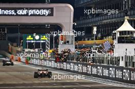 Race winner Max Verstappen (NLD) Red Bull Racing RB16 takes the chequered flag at the end of the race. 13.12.2020. Formula 1 World Championship, Rd 17, Abu Dhabi Grand Prix, Yas Marina Circuit, Abu Dhabi, Race Day.