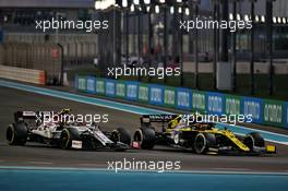 Antonio Giovinazzi (ITA) Alfa Romeo Racing C39 and Esteban Ocon (FRA) Renault F1 Team RS20 battle for position. 13.12.2020. Formula 1 World Championship, Rd 17, Abu Dhabi Grand Prix, Yas Marina Circuit, Abu Dhabi, Race Day.