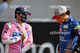 (L to R): Sergio Perez (MEX) Racing Point F1 Team with Carlos Sainz Jr (ESP) McLaren. 13.12.2020. Formula 1 World Championship, Rd 17, Abu Dhabi Grand Prix, Yas Marina Circuit, Abu Dhabi, Race Day.