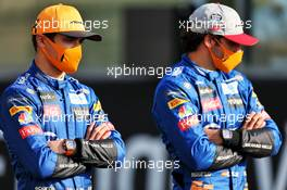 (L to R): Lando Norris (GBR) McLaren with team mate Carlos Sainz Jr (ESP) McLaren. 13.12.2020. Formula 1 World Championship, Rd 17, Abu Dhabi Grand Prix, Yas Marina Circuit, Abu Dhabi, Race Day.