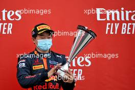 Race winner Yuki Tsunoda (JPN) Carlin celebrates on the podium.