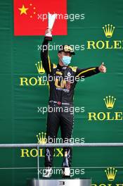 Guanyu Zhou (CHN) Uni-Virtuosi Racing celebrates his third position on the podium.