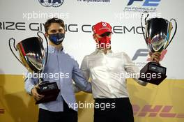 Oscar Piastri (AUS) PREMA Racing celebrates winning the 2020 FIA Formula 3 Championship and Mick Schumacher (GER) PREMA Racing celebrates winning the 2020 FIA Formula 2 Championship. 06.12.2020. FIA Formula 2 Championship Prize Giving Ceremony, Sakhir, Bahrain, Sunday.