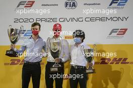 2nd place Callum Ilott (GBR) Uni-Virtuosi Racing with Mick Schumacher (GER) PREMA Racing celebrates winning the 2020 FIA Formula 2 Championship and Yuki Tsunoda (JPN) Carlin celebrates being 3rd. 06.12.2020. FIA Formula 2 Championship Prize Giving Ceremony, Sakhir, Bahrain, Sunday.
