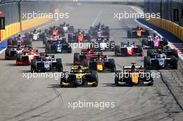(L to R): Guanyu Zhou (CHN) Uni-Virtuosi Racing and Jack Aitken (GBR) Campos Racing lead at the start of the race. 27.09.2020. FIA Formula 2 Championship, Rd 10, Sochi, Russia, Sunday.