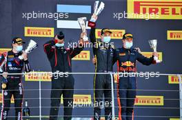 The podium (L to R): Louis Deletraz (SUI) Charouz Racing System, second; Christian Lundgaard (DEN) ART, race winner; Juri Vips (EST) Dams third.