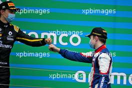 (L to R): Oscar Piastri (AUS) PREMA Racing and race winner David Beckmann (GER) Trident celebrate on the podium.