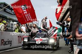 Race winners Brendon Hartley (NZL), Sebastien Buemi (SUI) and Kazuki Nakajima (JPN), driving the #08 Toyota Gazoo Racing Toyota TS050 Hybrid, celebrate at the end of the race.