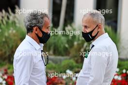 (L to R): Alain Prost (FRA) Alpine F1 Team Non-Executive Director with Stephane Cohen (BEL) Bell Helmet CEO. 26.03.2021. Formula 1 World Championship, Rd 1, Bahrain Grand Prix, Sakhir, Bahrain, Practice Day