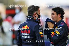 (L to R): Christian Horner (GBR) Red Bull Racing Team Principal with Sergio Perez (MEX) Red Bull Racing on the grid. 28.03.2021. Formula 1 World Championship, Rd 1, Bahrain Grand Prix, Sakhir, Bahrain, Race Day.