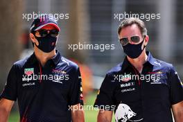 (L to R): Sergio Perez (MEX) Red Bull Racing with Christian Horner (GBR) Red Bull Racing Team Principal. 27.03.2021. Formula 1 World Championship, Rd 1, Bahrain Grand Prix, Sakhir, Bahrain, Qualifying Day.