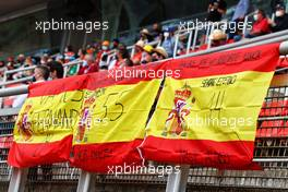 Circuit atmosphere - fans in the grandstand and flags for Fernando Alonso (ESP) Alpine F1 Team and Carlos Sainz Jr (ESP) Ferrari. 09.05.2021. Formula 1 World Championship, Rd 4, Spanish Grand Prix, Barcelona, Spain, Race Day.