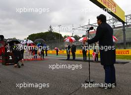 The grid observes the national anthem. 18.04.2021. Formula 1 World Championship, Rd 2, Emilia Romagna Grand Prix, Imola, Italy, Race Day.