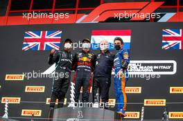 The podium (L to R): Lewis Hamilton (GBR) Mercedes AMG F1, second; Max Verstappen (NLD) Red Bull Racing, race winner; Karl Sengstbratl, Red Bull Racing Finance & Operations Director; Lando Norris (GBR) McLaren, third. 18.04.2021. Formula 1 World Championship, Rd 2, Emilia Romagna Grand Prix, Imola, Italy, Race Day.