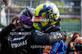 (L to R): Lewis Hamilton (GBR) Mercedes AMG F1 celebrates his second position with third placed Lando Norris (GBR) McLaren in parc ferme. 18.04.2021. Formula 1 World Championship, Rd 2, Emilia Romagna Grand Prix, Imola, Italy, Race Day.