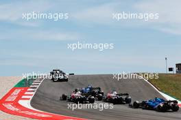 George Russell (GBR) Williams Racing FW43B leads Antonio Giovinazzi (ITA) Alfa Romeo Racing C41, Kimi Raikkonen (FIN) Alfa Romeo Racing C41 and Fernando Alonso (ESP) Alpine F1 Team A521. 02.05.2021. Formula 1 World Championship, Rd 3, Portuguese Grand Prix, Portimao, Portugal, Race Day.